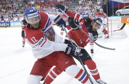 czech republicís jiri novotny, left, challenges for the puck with canadaís ryan oíreilly, right, during the hockey world championships semifinal match in prague, czech republic, saturday, may 16, 2015. (ap photo/petr david josek)
