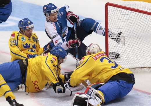 finland's eero elo, top, tries to score past swedenís goalie erik fasth, right, during the second period action of the channel one cup ice hockey match between sweden and finland, in moscow, russia, on sunday, dec. 20, 2015. (ap photo/ivan sekretarev) ishockey sverige tre kronor /ah