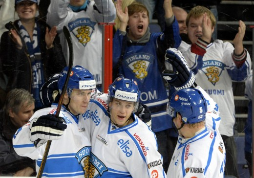 finland's goal scorer jori lehtera left, celebrates the game winning goal with teammates jonas enlund, center, lasse kukkonen during the euro hockey tour karjala cup ice hockey match between finland and czech republic in helsinki, saturday, nov. 9, 2013. finland won the match 3-2. (ap photo/jussi nukari, lehtikuva)  finland out   publicerad text: